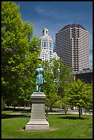 Statue in park and high-rise buildings. Hartford, Connecticut, USA (color)