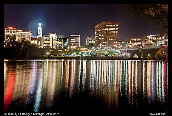 Skyline of Hartford reflected in Connecticut River at night. Hartford, Connecticut, USA