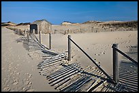 Fallen sand fence and footprints, Cape Cod National Seashore. Cape Cod, Massachussets, USA (color)