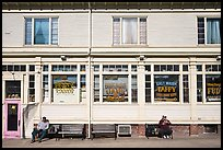 Men sitting in front of candy store, Provincetown. Cape Cod, Massachussets, USA ( color)