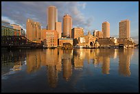 Boston skyline from harbor, sunrise. Boston, Massachussets, USA (color)