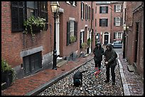 Women walking dog on rainy day, Beacon Hill. Boston, Massachussets, USA