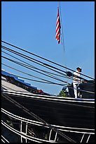 Sailor and flag on USS Constitution (9/11 10th anniversary). Boston, Massachussets, USA (color)