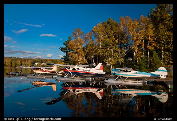 Floatplanes and reflections in Moosehead Lake  late afternoon, Greenville. Maine, USA (color)