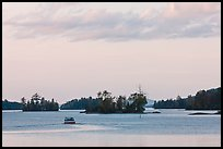 Motorboat and islets at sunset,  Moosehead Lake, Greenville. Maine, USA