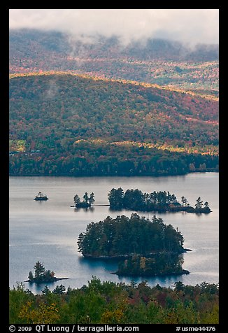 Islets and mountain slopes with fall foliage. Maine, USA (color)