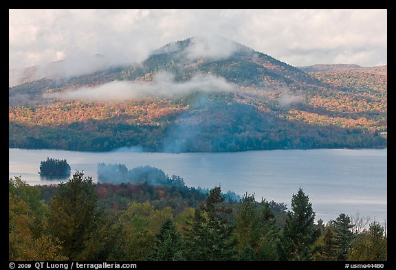 Autumn scenery with lake and clouds lifting up. Maine, USA (color)
