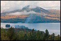 Autumn scenery with lake and clouds lifting up. Maine, USA