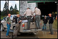 Game wardens check antler length of killed moose, Kokadjo. Maine, USA