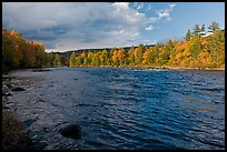 Fast-flowing Penobscot River and fall foliage. Maine, USA ( color)