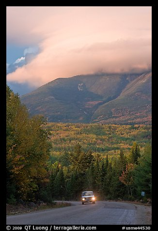 Truck on road below cloud-capped Katahdin. Maine, USA (color)