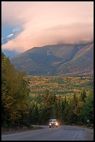 Truck on road below cloud-capped Katahdin. Maine, USA ( color)