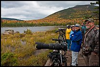Wildlife photographers on observation platform, Sandy Stream Pond. Baxter State Park, Maine, USA (color)