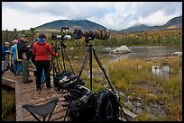 Cameras set up with telephoto lenses, Sandy Stream Pond. Baxter State Park, Maine, USA