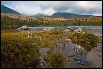 Mountains with fall colors rising above pond. Baxter State Park, Maine, USA