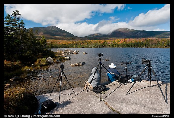 Photographers at Sandy Stream Pond waiting with cameras set up. Baxter State Park, Maine, USA