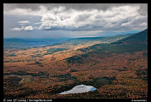 View with storm light and clouds over slopes covered with fall foliage. Baxter State Park, Maine, USA (color)