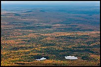 Ponds and forested landscape in autumn with spots of light. Baxter State Park, Maine, USA