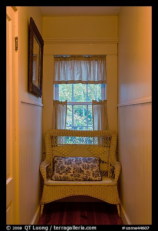 Corridor in inn with chair and window looking out to trees. Maine, USA (color)