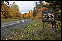 Road with Allagash wilderness sign. Allagash Wilderness Waterway, Maine, USA (color)