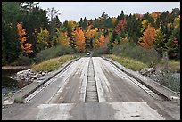 Wood bridge in the fall. Allagash Wilderness Waterway, Maine, USA (color)