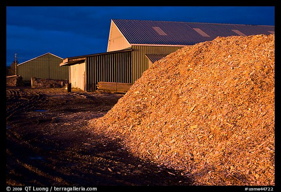 Sawdust in lumber mill at night, Ashland. Maine, USA