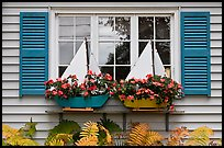 Window with flower pots shaped like sailboats. Bar Harbor, Maine, USA ( color)