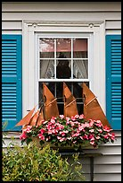 Window with decorative sailboat and flowers. Bar Harbor, Maine, USA (color)