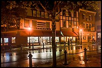Street with wet pavement at night. Bar Harbor, Maine, USA