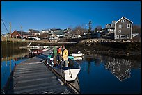 Men preparing to leave on small boat. Stonington, Maine, USA (color)