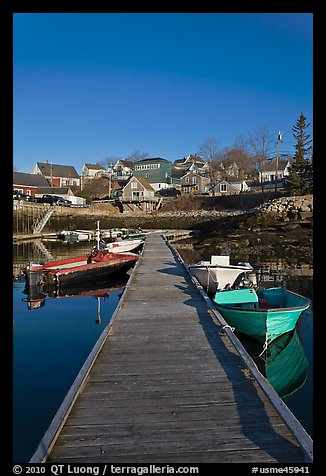 Deck, small boats, and houses. Stonington, Maine, USA (color)