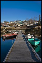 Deck, small boats, and houses. Stonington, Maine, USA ( color)
