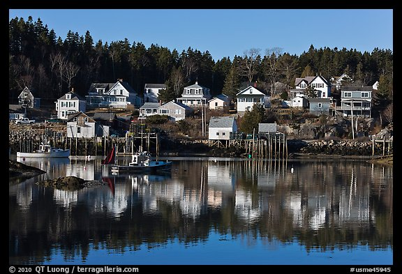 Reflection of hillside houses. Stonington, Maine, USA