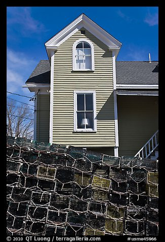 Lobster traps and house. Stonington, Maine, USA