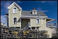 Lobster traps lined in front of house. Stonington, Maine, USA (color)