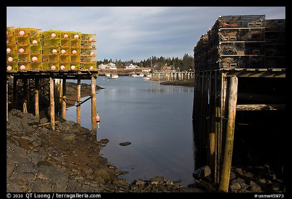 Lobster traps framing harbor. Corea, Maine, USA