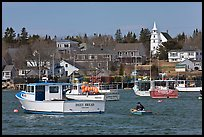 Lobsterman paddling towards boat. Corea, Maine, USA ( color)