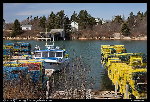 Lobster traps and boat. Corea, Maine, USA