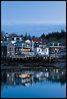 Houses with lights reflected in harbor. Stonington, Maine, USA ( color)