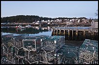 Lobster traps, pier, and village at dawn. Stonington, Maine, USA (color)