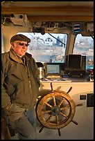 Captain of Isle-au-Haut mailboat aboard boat. Isle Au Haut, Maine, USA ( color)