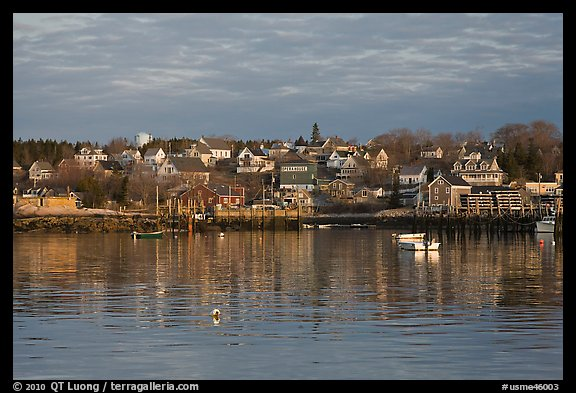 Harber and hillside houses at sunrise. Stonington, Maine, USA (color)