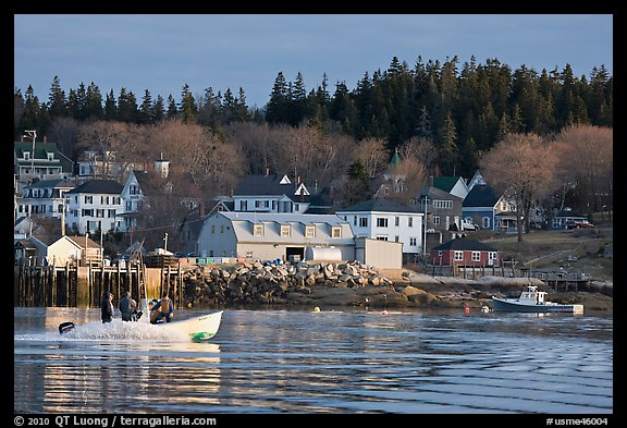 Men on small boat in harbor. Stonington, Maine, USA (color)