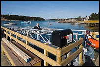Mailbox and people unloading mailboat. Isle Au Haut, Maine, USA ( color)