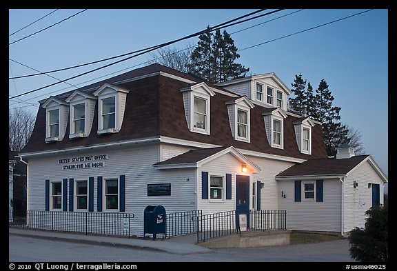 Post office in federal style at dusk. Stonington, Maine, USA (color)