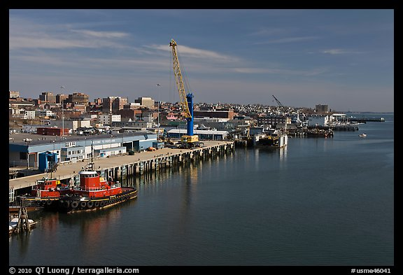 Shipping harbor with tugboats and crane. Portland, Maine, USA (color)