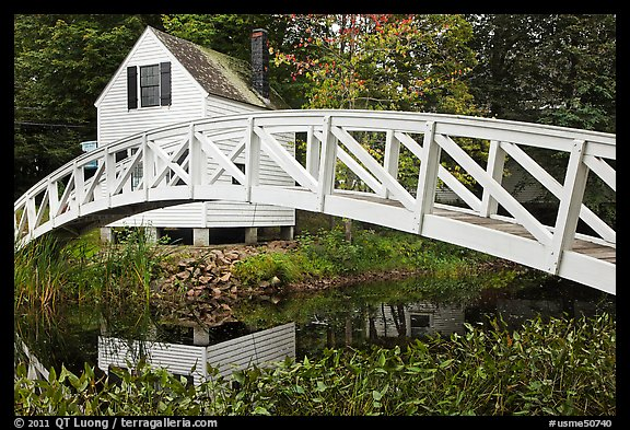 Arched bridge over mill pond. Maine, USA