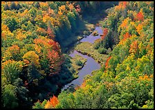 River with curve and fall forest from above, Porcupine Mountains State Park. USA ( color)