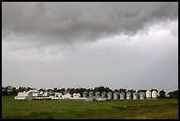 Storm clouds over grain silos. North Dakota, USA (color)