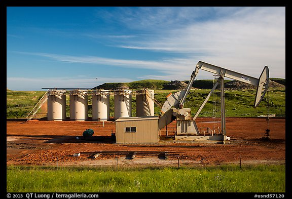 Pumping unit and tanks, oil well. North Dakota, USA (color)